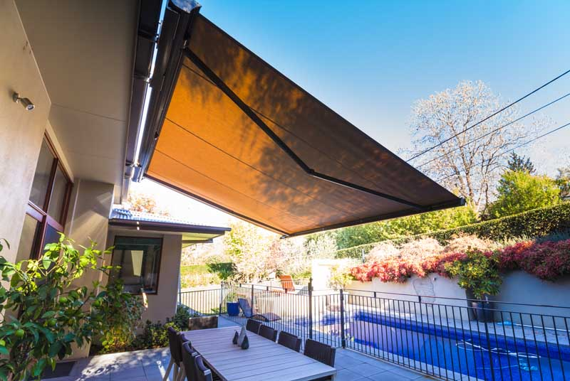 Folding Arm Awnings In Backyard